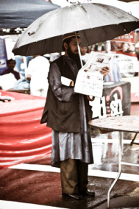 Sikn gentleman reading newspaper